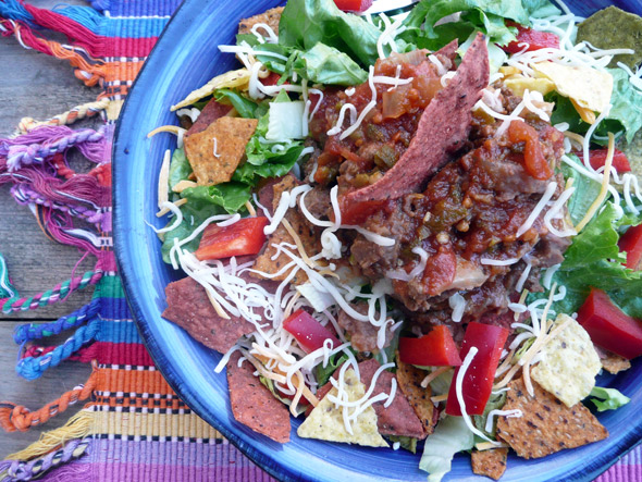 Taco Salad with Beef, Beans, Cheese, Bell Pepper, Onion and Vegie Corn Chips