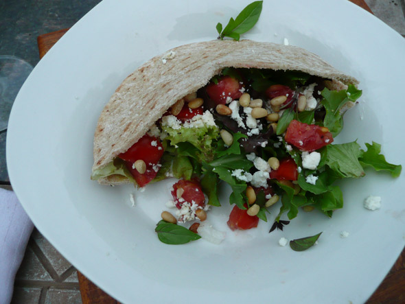 Pita with hummus, mixed greens, goat cheese, feta, tomato & toasted pinons