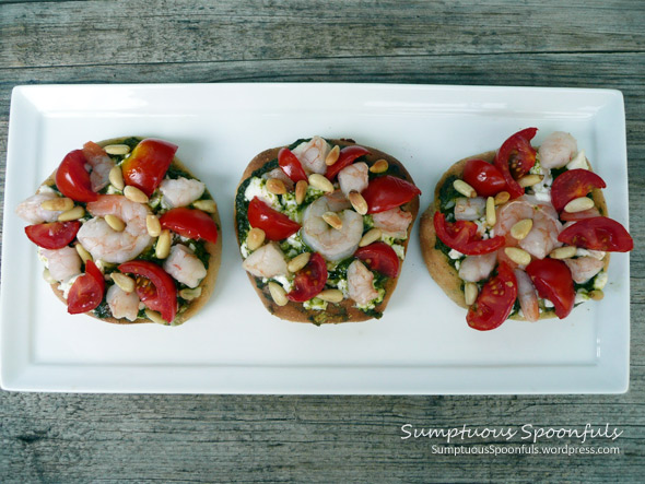 Pesto Shrimp Mini Pizzas with Grape Tomatoes, Goat Cheese & Pinons