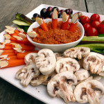 "Halloween Veggie Tray with Mushroom ""Skulls"", Carrot ""Fingers"" and goblin eyes ~ Sumptuous Spoonfuls #halloween #party #idea"