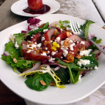 Red Wine Poached Pear Salad with Goat Cheese, Cinnamon Roasted Almonds and a Red Wine Pear Vinaigrette ~ Sumptuous Spoonfuls #elegant #pear #salad #recipe